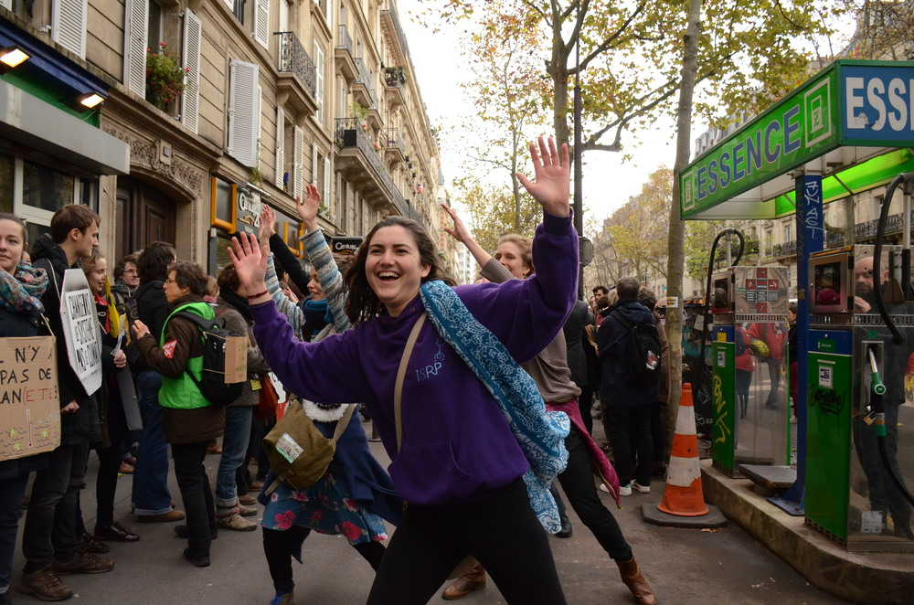 Activists dance on the streets of Paris near the human chain, despite the heavy police presence.