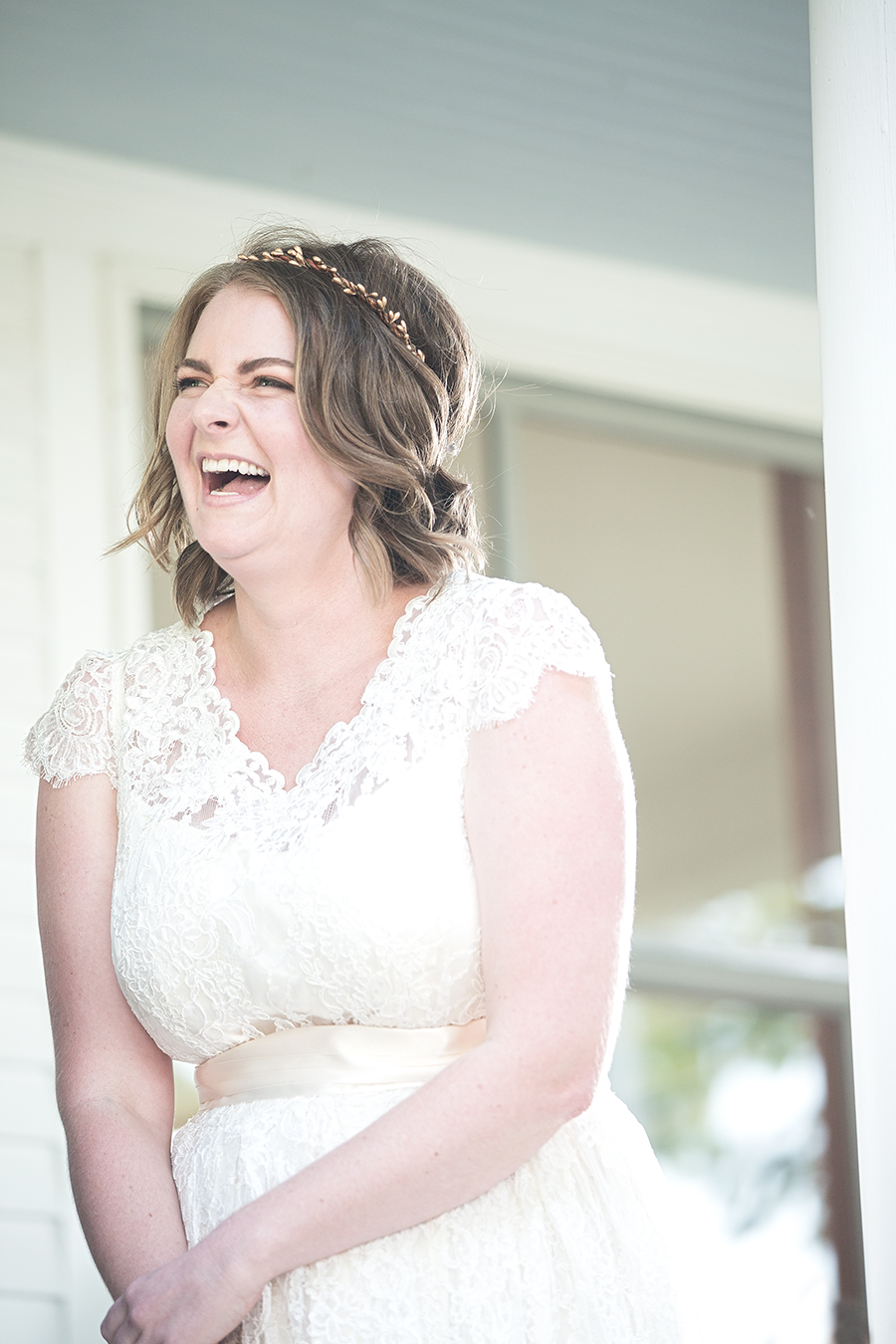 bride laugh ceremony porch(WEB).jpg