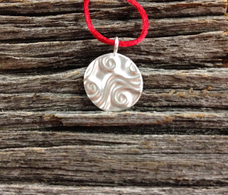 (Note: This pendant is sold). Doodle pendant, after firing and polishing... this image is just a little blurry so I included the before-firing photos which are quite sharp, to show what the pattern on the surface looks like.