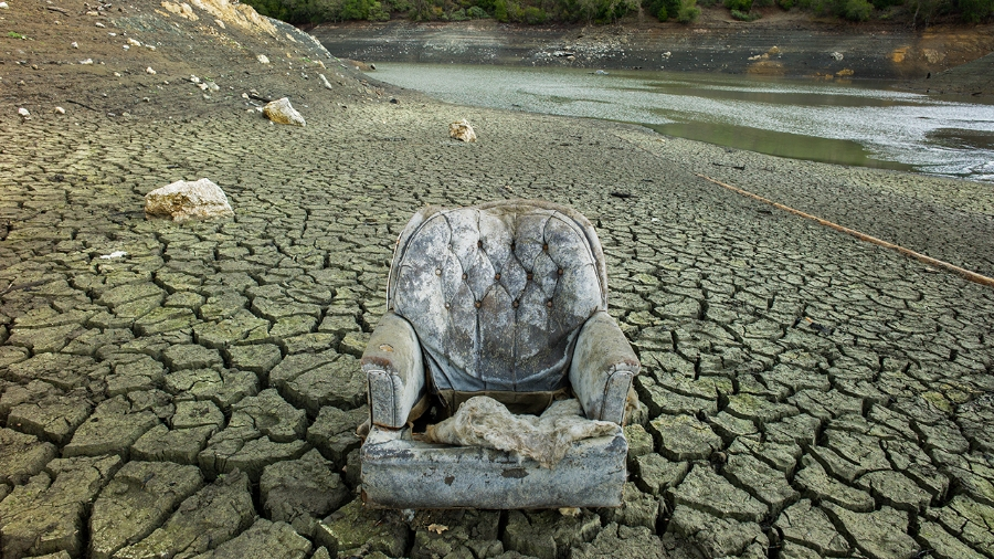Loss of Habitat?  Swivel Chair Stranded as Reservoir Runs Dry. Photo by James Ting:   Sofa Chair from Evidence I series  , 2/8/14, Alamden Reservoir, CA.   James Ting 's work was on display at the Watchung Center for the Arts until October 27.