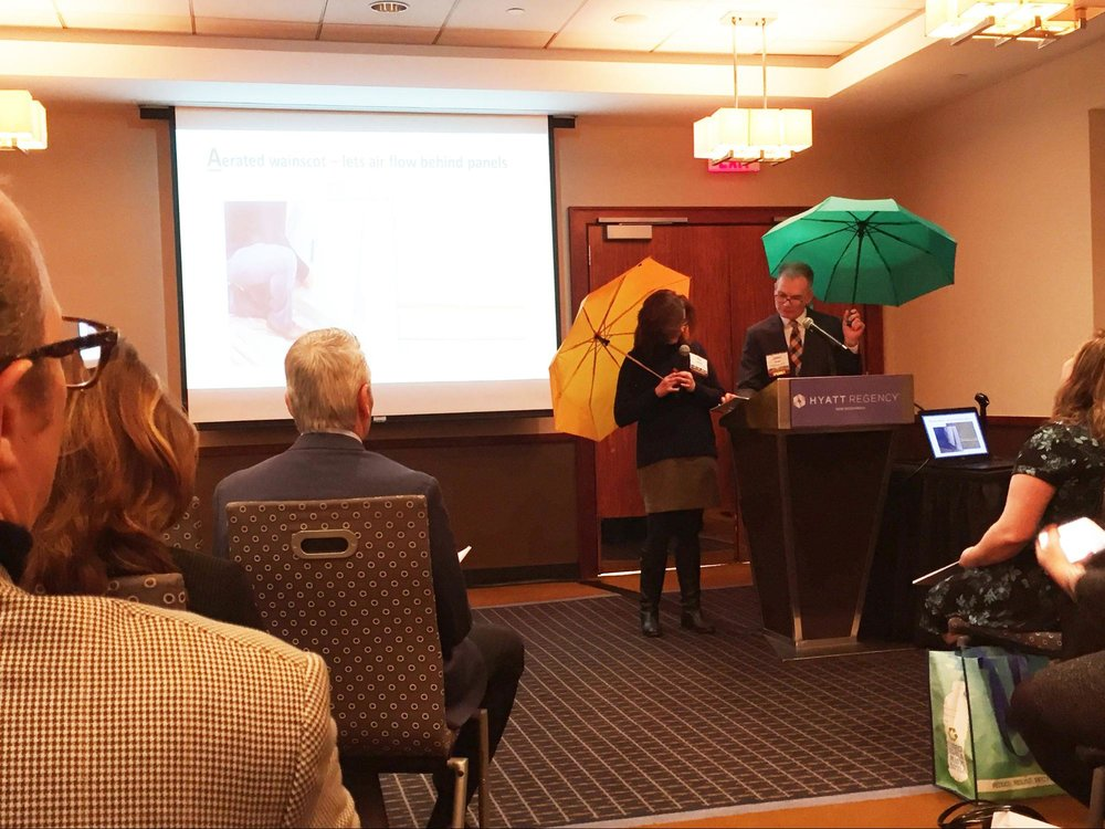 Ignite! Redevelopment presenters on flood-proofing brought umbrellas and a sense of humor