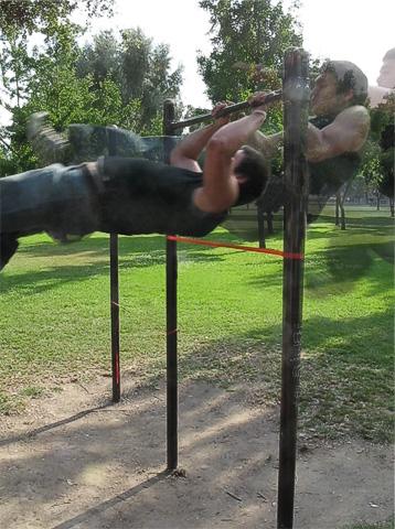 Kellen jumping under chin-up bar