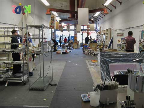 Customers sorting through sale items. Gone are several full-length rows of displays