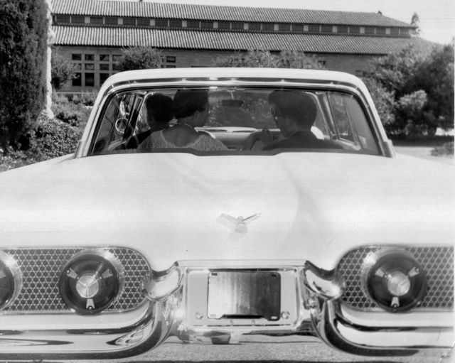 My parents at their wedding, riding in Uncle Easy's '58 Thunderbird