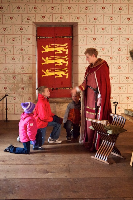 Kids being knighted at the Tower of London