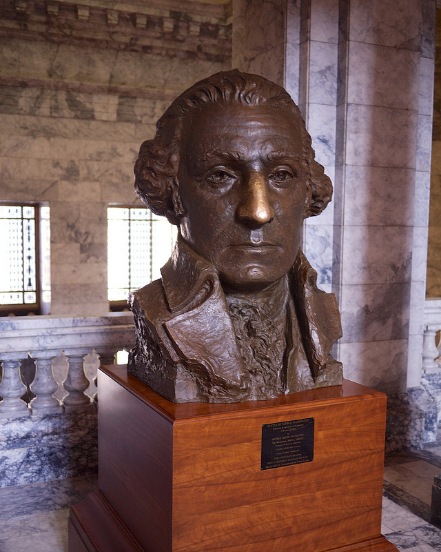 Statue of George Washington with well-polished nose