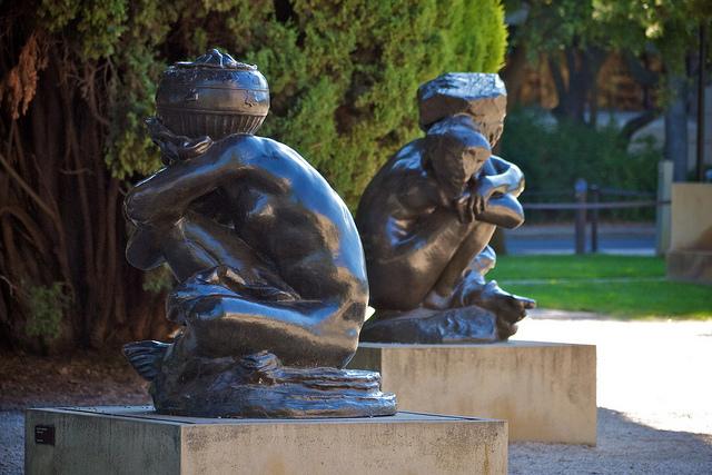 Rodin's Fallen Caryatids carrying an urn and a rock