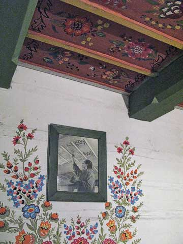 Replica of a painted ceiling, along with a photo showing the person doing the painting.