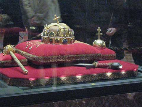 The Hungarian Crown was sent to Hungary by pope Sylvester II to crown István, the country's first Christian king. It's unknown how the cross on the top got bent over. The crown was kept safe at Fort Knox during WWII, and was returned to Hungary during the Carter administration. With the crown are the sceptre (to the left), orb (to the right), and coronation sword (underneath).