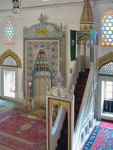 The niche (mihrab) is oriented towards Mecca, while the stairway (mimber) is symbolic of the growth of Islam, since Muhammad had to stand higher and higher to talk to his growing following. Similarly, the cleric gives speeches from these stairs, but the top stair is symbolically reserved for Muhammed.