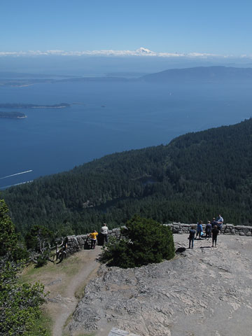 The view on the summit is popular (facing east towards Bellingham, Lummi Island, Mount Baker).