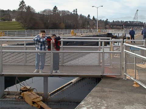 Kellen and Tynor on the walkway over one of the small lock gates.