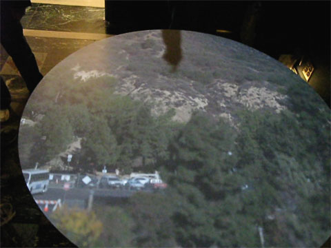 The Camera Obscura uses lenses and mirrors to project a live image from outside onto a screen near the floor. The projection from the redone camera is quite large. The bus on the lower left is one of the shuttles used to shuttle people from a satellite parking lot during the first several months after opening. Considering how many people were in the observatory, it would have been total gridlock if cars were allowed to park up at the observatory itself.
