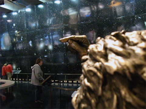 This is but a small portion of an exhibit called  The Big Picture . The 152 feet long by 20 feet high image shows over 1.5 million objects, mostly galaxies. The statue of Einstein in the foreground demonstrates how much sky is represented in the picture; if you hold your finger as in the statue, you would block out about the same amount of sky as in the mural. Naturally, it's very popular to sit on the bench next to the statue and pose with him; the docent said that she had seen it all, and some of her stories made us not want to touch the finger!