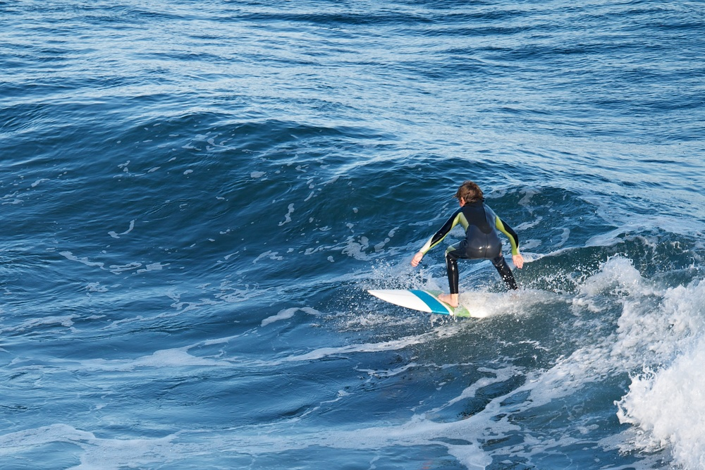 One of many surfers