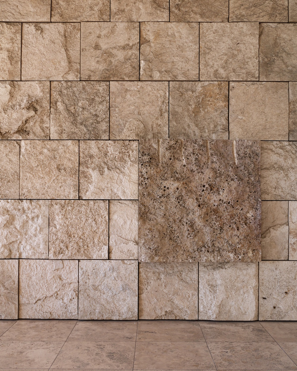 The strong square motif can be seen here, including a display block of travertine.