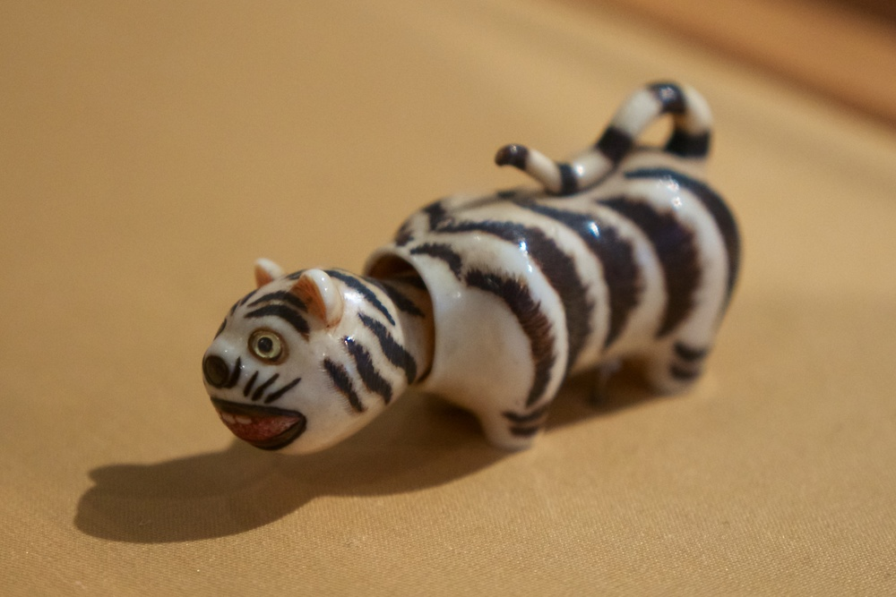 Netsuke: Tiger Doll (you rotate the tail and the head bobs up and down)