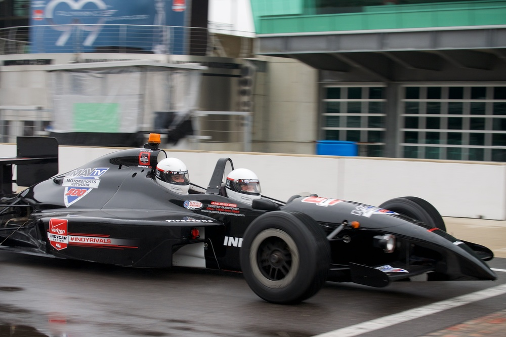 Two seat car going by in the pit lane