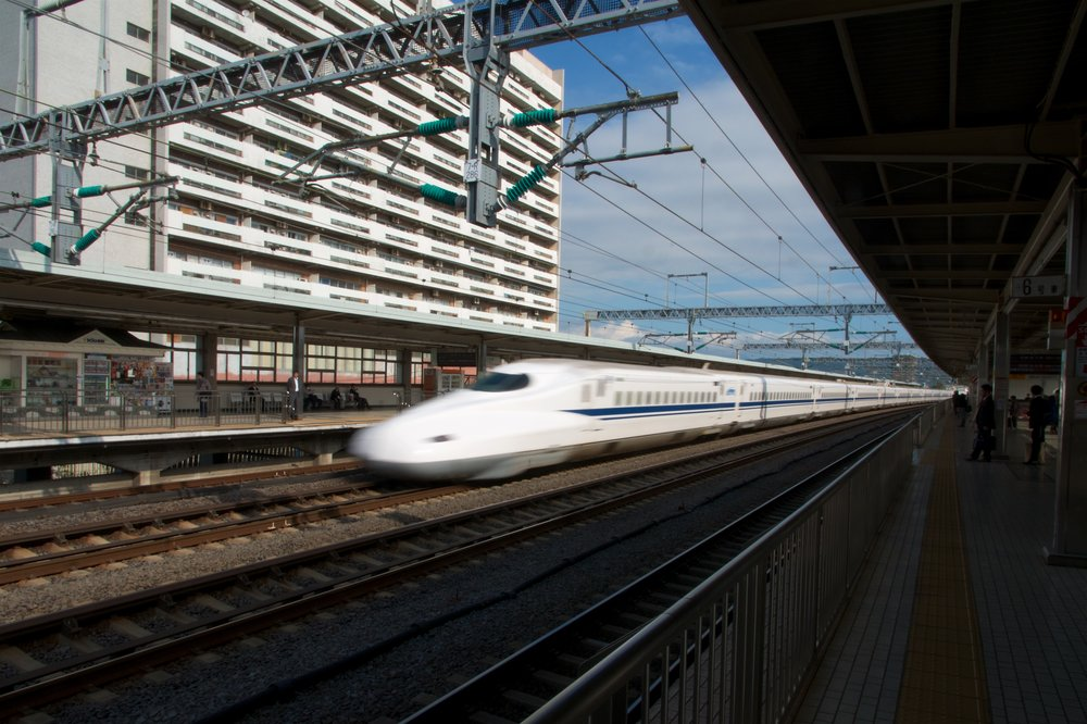 Shinkansen going through the station