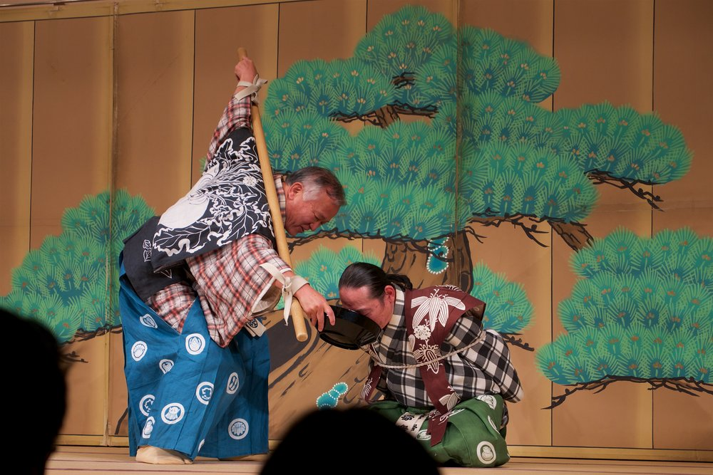 Servants drinking sake in the Kyogen play