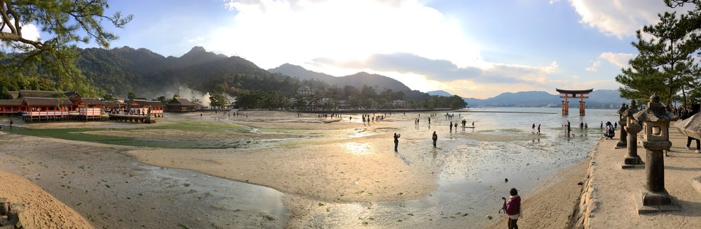 People nearing Otorii as the tide goes out