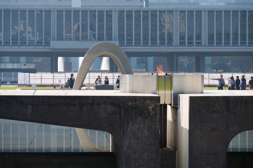 Flame, cenotaph, and Hiroshima Peace Memorial Museum