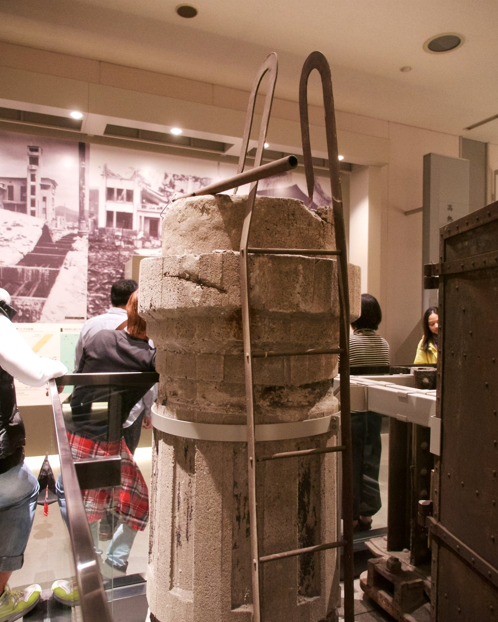 Part of a smokestack which withstood the bombing