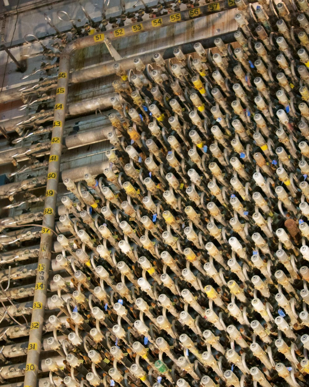Several of the over 2,000 tubes in the reactor, and the numbers used to identify each tube in the grid