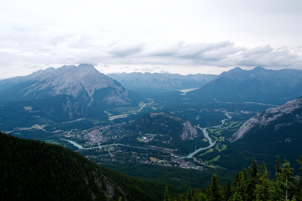 Banff town with Tunnel Mountain in the middle and Lake Minnewanka in the background