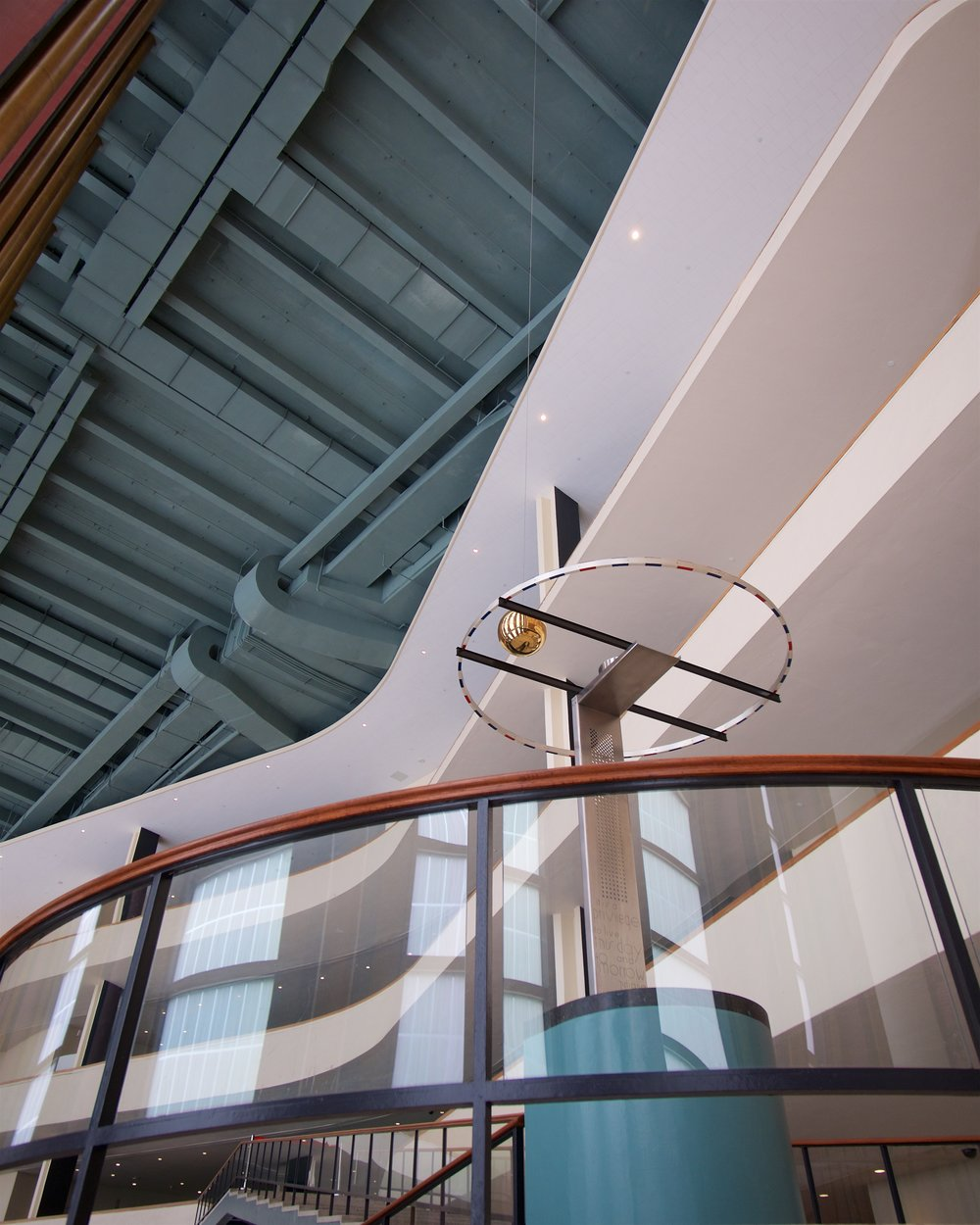 Stairs in lobby with Focault pendulum