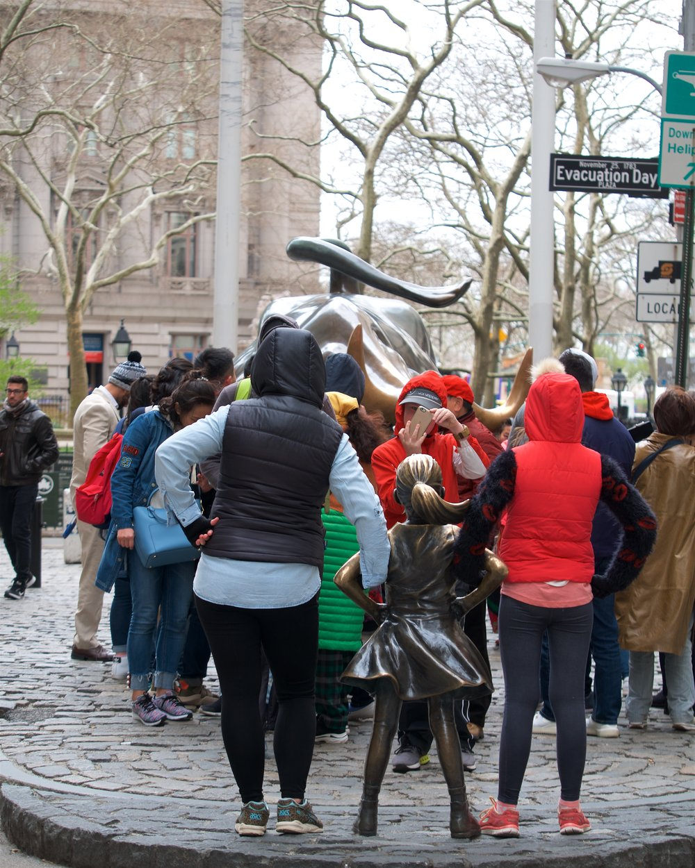 Crowd around Fearless Girl and Charging Bull