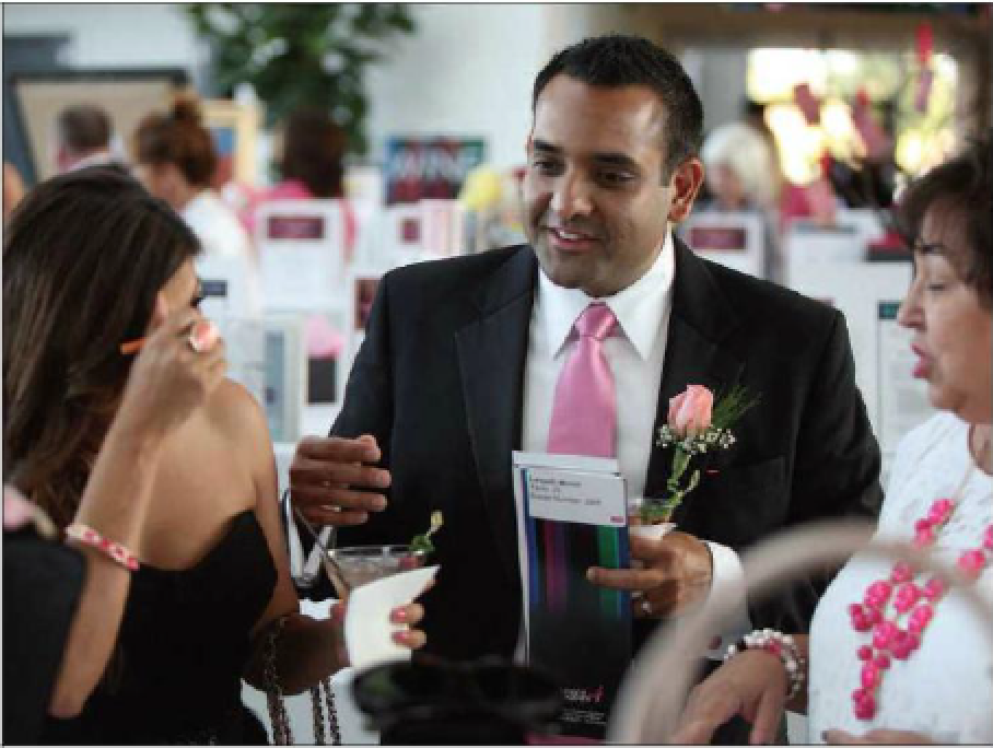 Dr. Monish Laxpati & Amee Laxpati (COO of Alinea) talking with a guest at the Pink Tie Ball, May 10, 2014.