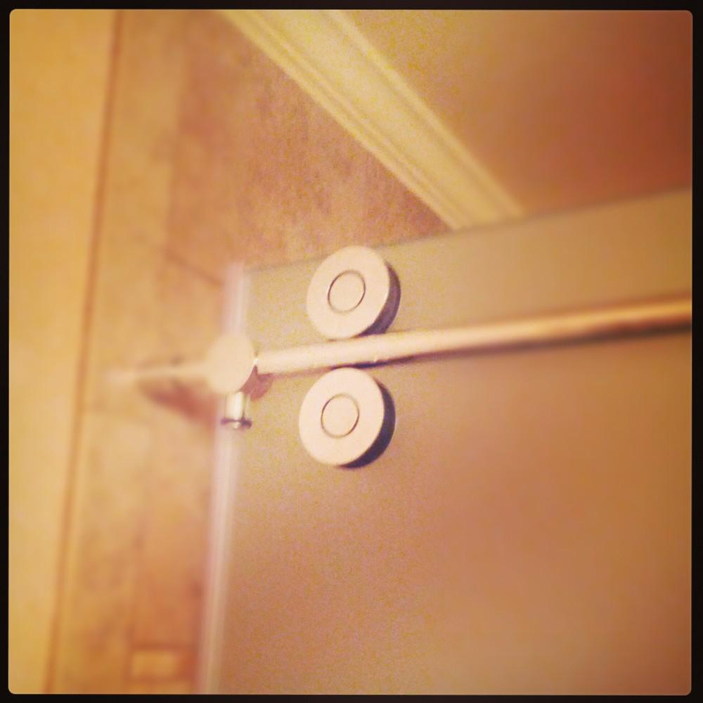 My father's guest bathroom shower door track