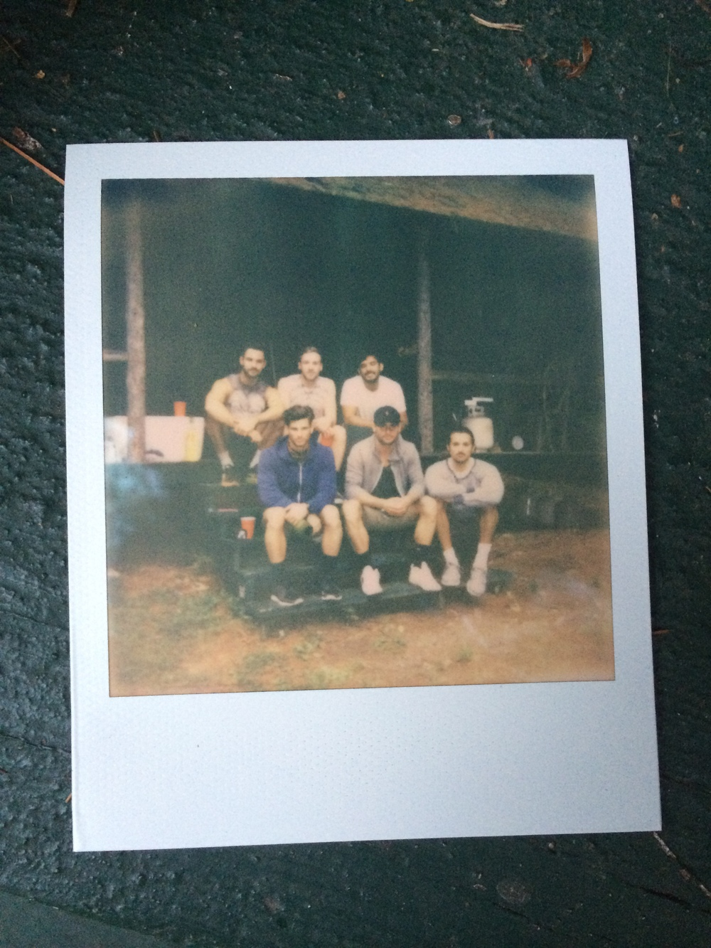 The boys in front of Mr. Philbrook's true Americana hunting cabin.