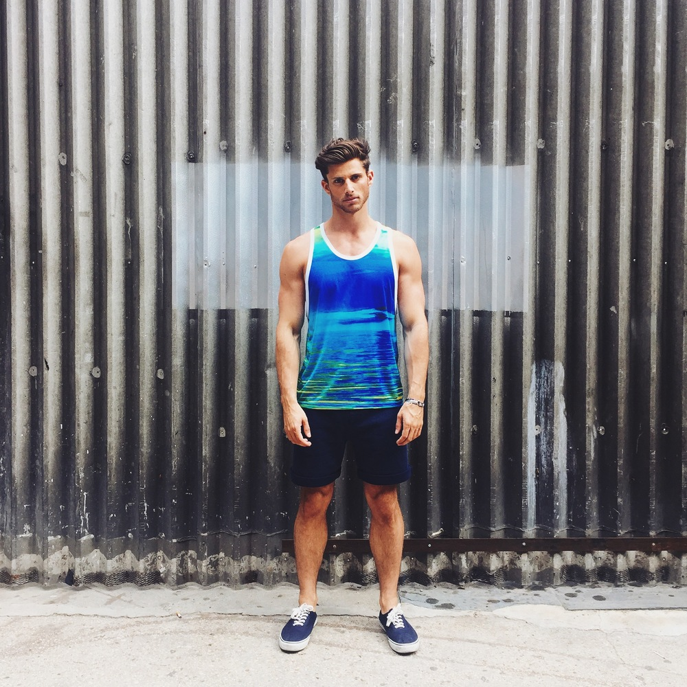 Barrett wears Horizon Tank and Navy Terry Shorts