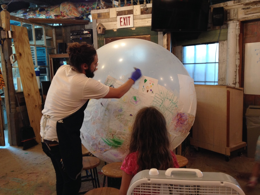 Bill helping young makers design the mirror ball.