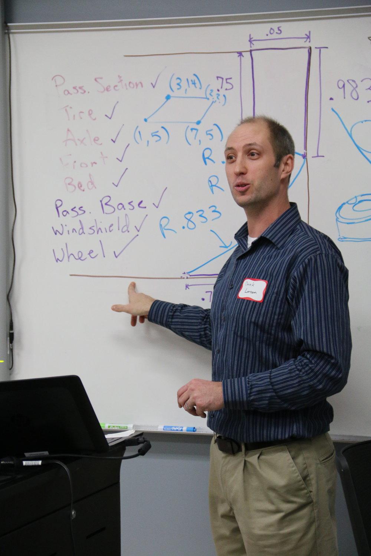 Derek Larson explaining a design challenge