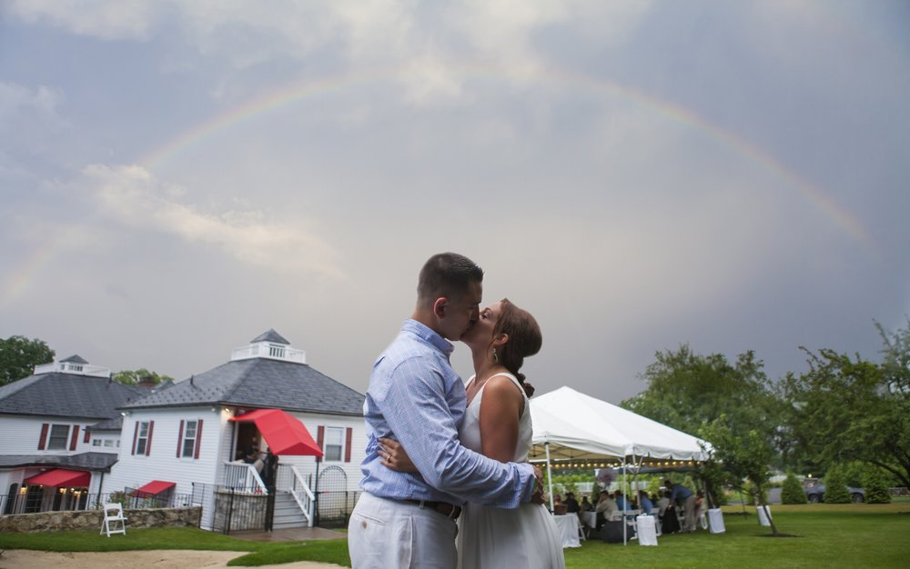 Connecticut engagement photography under a rainbow in Danbury.
