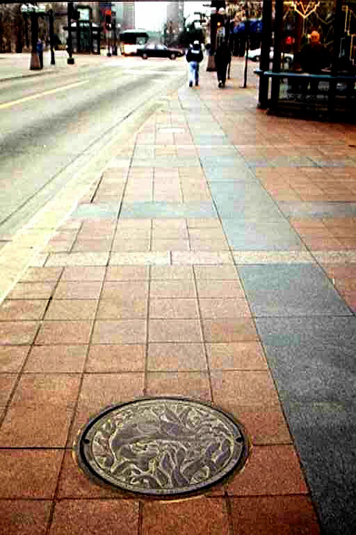 © 2016 Kate Burke, installed Walleye manhole cover at Nicollet Mall in Minneapolis, Minnesota