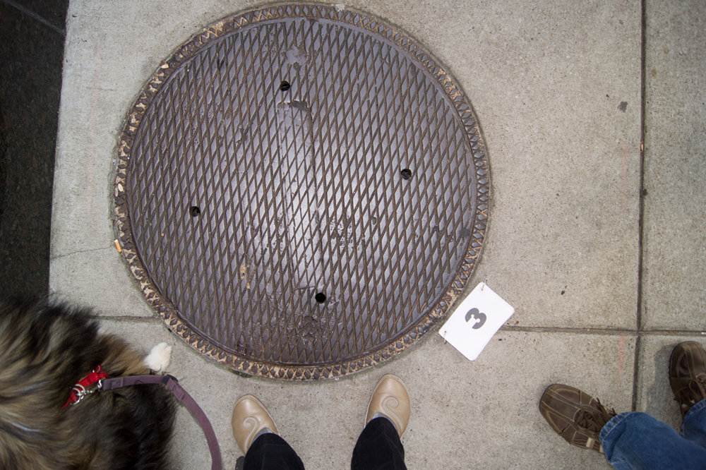 © 2012 Louise Levergneux, manhole cover documented at Church St & 4th Ave N in Nashville, Tenessee, on September 9, 2012
