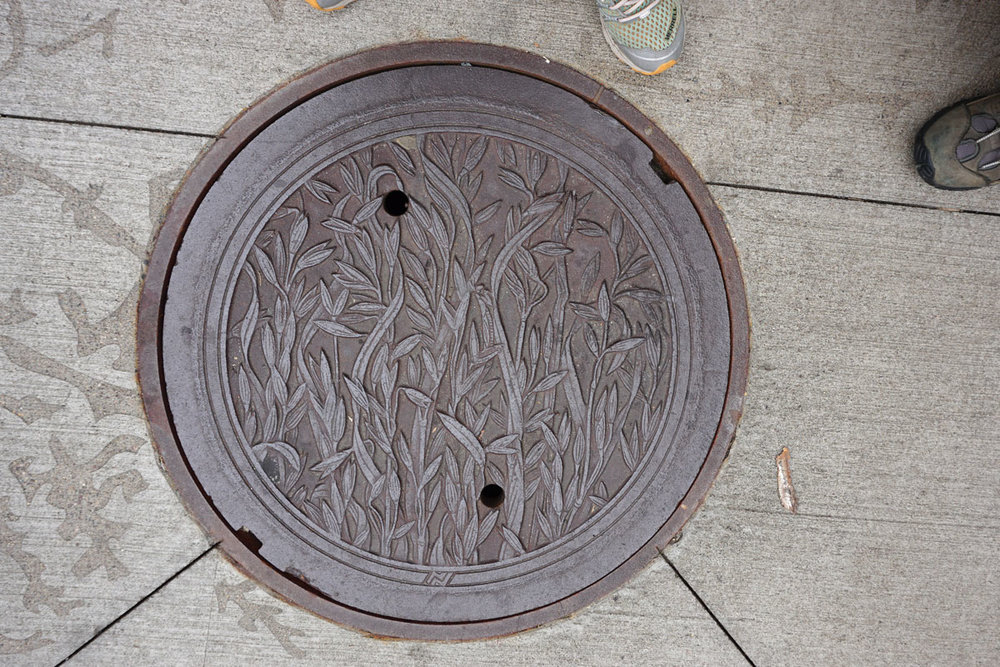 © 2018 Louise Levergneux. Oats, manhole cover on Nicollet Mall, designed by Kate Burke.