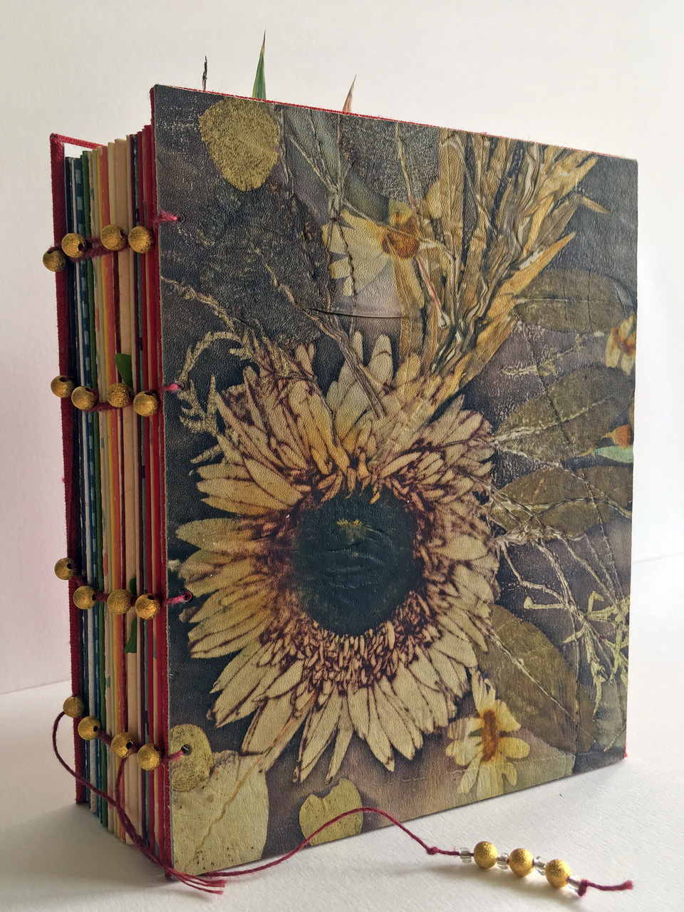 © 2019 Merike van Zanten. Gerbera Daisy, coptic bound notebook with eco printed leather cover from Merike's residency,