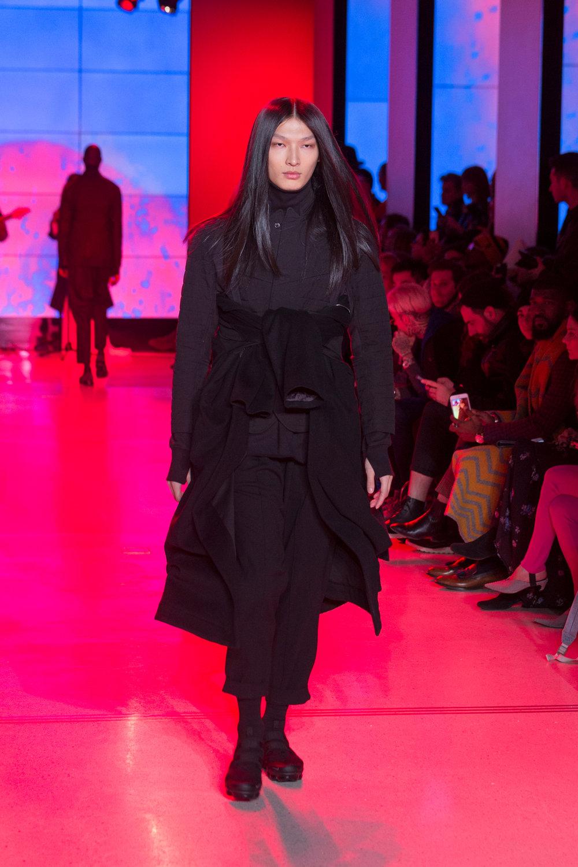 LOOK 2   ARC BDU Jacket  / Black Quilted Cotton   ARC Orison Coat  / Black Cashmere   ARC Turtleneck  / Black Terry   ARC Ankara Pant  / Black Wool   Nike Air VaporMax Utility