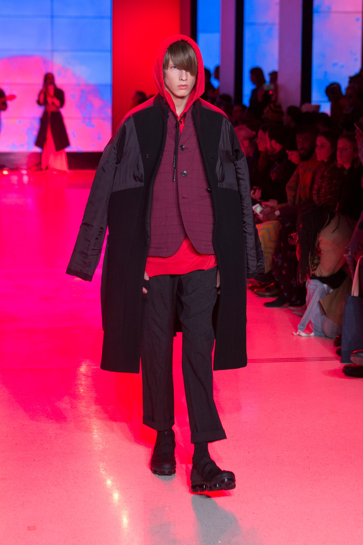 LOOK 18   ARC Overcoat  / Black   ARC BDU Jacket  / Oxblood   ARC Hood Sweatshirt  / Crimson Red   ARC Ankara Pant  / Black   Nike Air VaporMax Utility   .