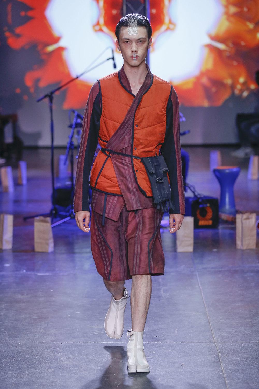LOOK 19   ARC Atlas Vest  / Orange   ARC Kimono Shirt  / Maroon Stripe   ARC Kyoto Short  / Maroon Stripe   ARC Shoulder Bag  (Worn on Waist)   ARC Apollo Tabi Boot