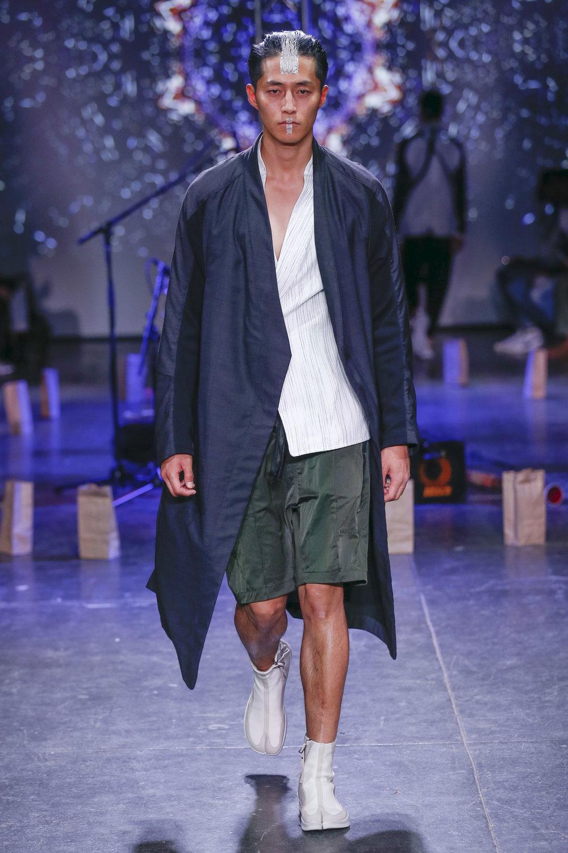 LOOK 5   ARC Phantom Coat  / Black Tropical Wool   ARC Kimono Shirt  / White Broken Stripe   ARC Atlas Short  / Olive   ARC Apollo Tabi Boot   .