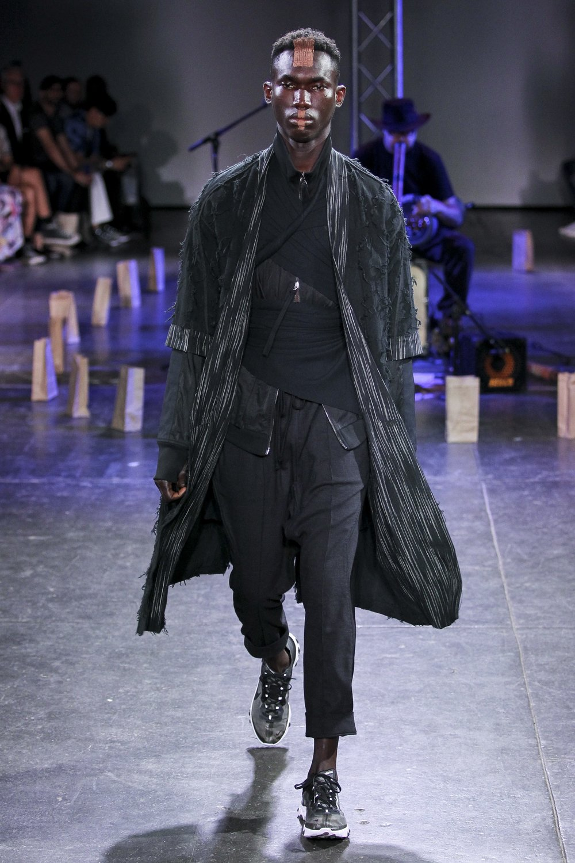 LOOK 1   ARC Noragi  / Black Fray   ARC Track Jacket  / Black   ARC Ankara Pant  / Black Wool   Nike React Element 87