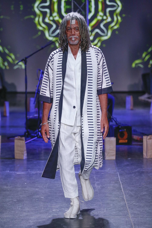 LOOK 30   ARC Noragi  / Black & White Sarti   ARC Desert Shirt  / White   ARC Ankara Pant  / White   ARC Apollo Tabi Boot