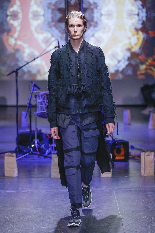 LOOK 6   ARC Flight Jacket  / Black Fray   ARC Kimono Shirt  / Black Tropical Wool   ARC Tactical Pant  / Navy Ripstop   ARC Shoulder Bag  (Worn on Neck)   Nike React Element 87