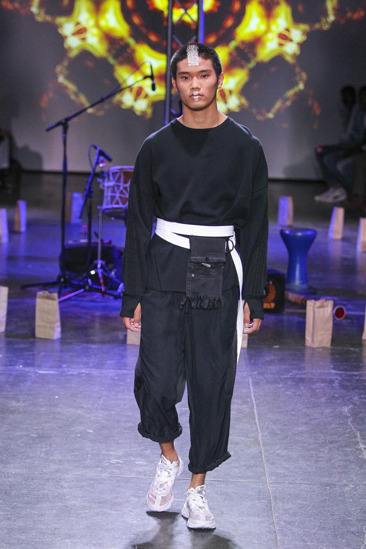 LOOK 12   ARC Desert Sweatshirt  / Black   ARC Taos Pant  / Black   ARC Wrap Belt  / White   ARC Shoulder Bag  (Worn on Belt)   Nike React Element 87